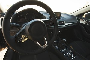 Steering wheel of a car. Car dashboard.
