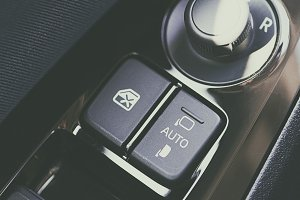 Control buttons of mirrors and windows of the car. Car dashboard.