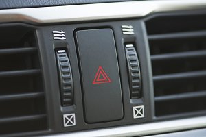 Emergency button of the car that activates the four indicators and indicates an emergency. Car dashboard.