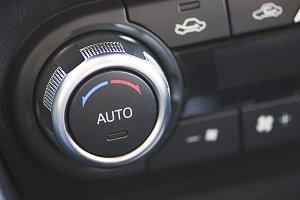 Car air conditioner button. Car dashboard.