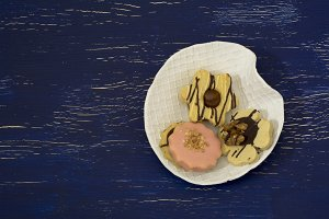 three teacakes on blue background, h