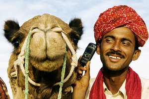Indian man and camel on the phone