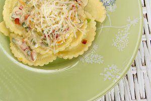 ravioli and vegetable garnish  on wo