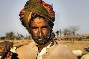 Indigenous Indian man herding sheep