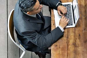 Business person using laptop