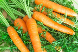 Fresh and sweet carrots background