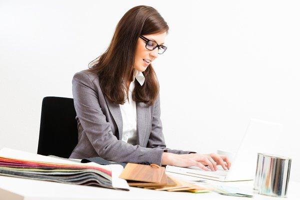 Female Interior Designer At Her Des…