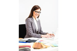 Female Interior Designer At Her Desk