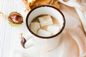 Fall still life with yellow leaves, coffe with marshmallows and