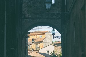 Arch between houses on a narrow street in Rome