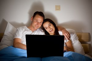 Happy Couple Watching A Video
