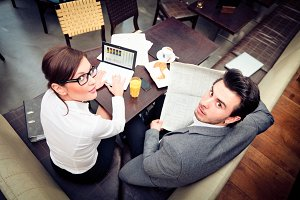 Young Business Couple In A Cafe