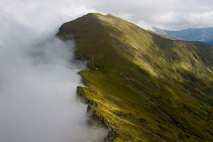 Misty mountain surrounded by clouds