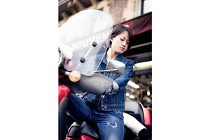 Young Chinese Female On Scooter