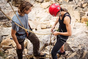 Young Climbers Checking Equipment