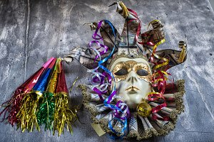 Venetian carnival mask and blowers