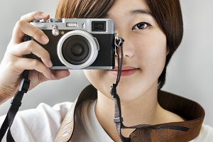 Asian Girl Taking Pictures