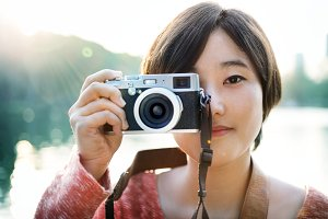 Asian Girl Taking Pictures By Camera