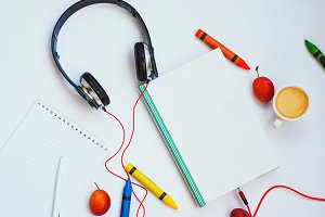 audiobook concept. headphones and book on a white background