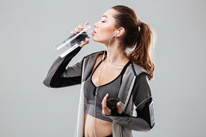 Side view of a tired woman drinking water