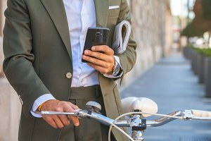 gentleman in suit with bicycle