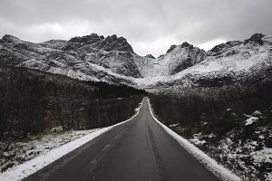 Lone mountain road in winter