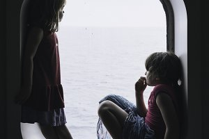 Two little girls looking at sea