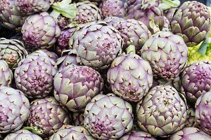 Red artichokes at market