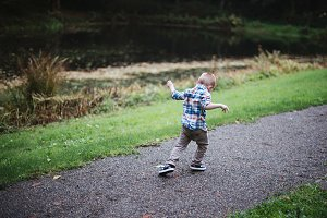 Little Boy Dancing in a Park