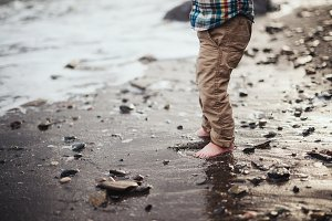 Child Barefoot on Beach