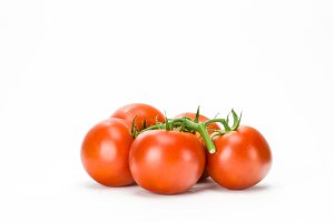 Red tomatoes on white