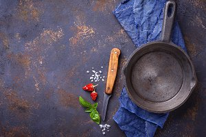 Empty cast iron fried pan with herbs and spices