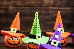 Halloween Card with cute little pumpkin heads in witch hats
