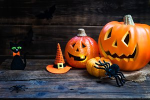 Halloween accessories such as pumpkin heads, spiders, hat and ca