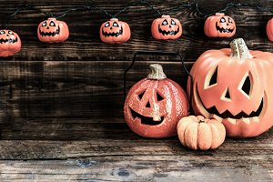 Halloween pumpkin heads on wooden background
