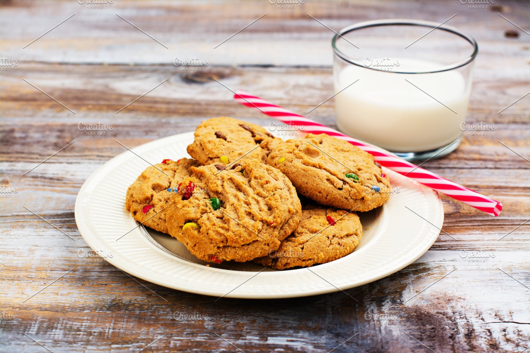 Milk And Cookies For Santa Claus And Santa S Hat Over Wooden Bac