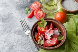 Salad of ripe red tomatoes, onion