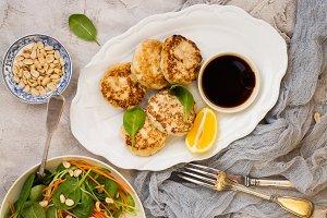 Chicken patties on white dish