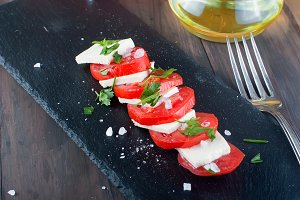 Tomatoes and soft cheese