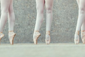 Closeup of legs of three ballet