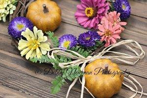 Fall flowers pumpkins & raffia bow