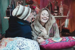 Couple Laughing in Bohemian Tent