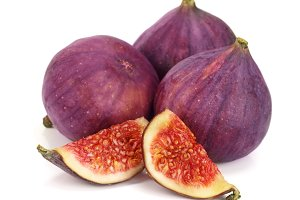 fig fruits with slices isolated on white background
