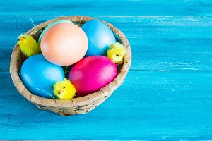 Colored eggs in the basket