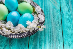 colored eggs on a wooden background