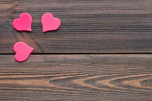 hearts on a wooden background.