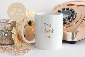 Mug mockup with peach gerberas