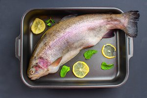 raw trout in baking dish.