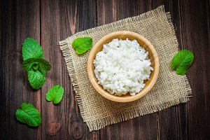 White rice in bowl on a wooden background
