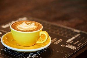 Latte mug yellow on old iron table